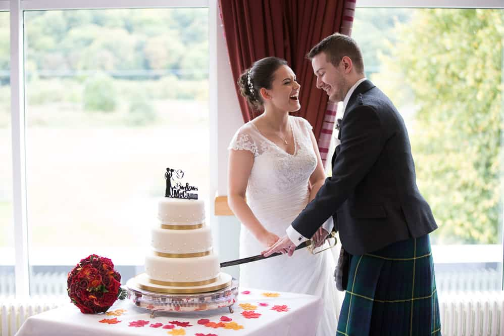 17 bride and groom cutting cake