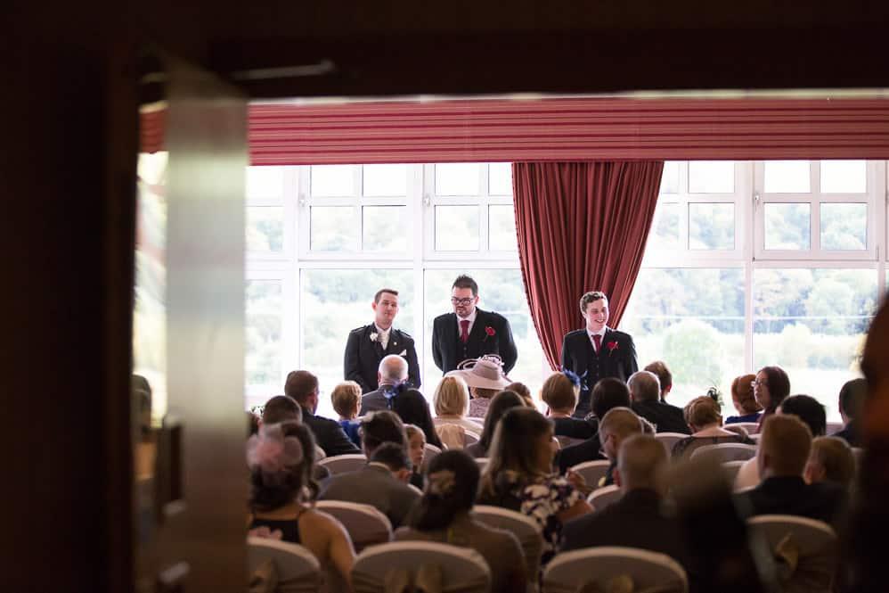 6 groom with bestmens awaiting bride