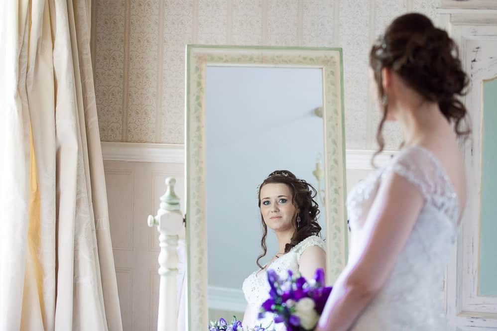 3 bride reflection in mirror