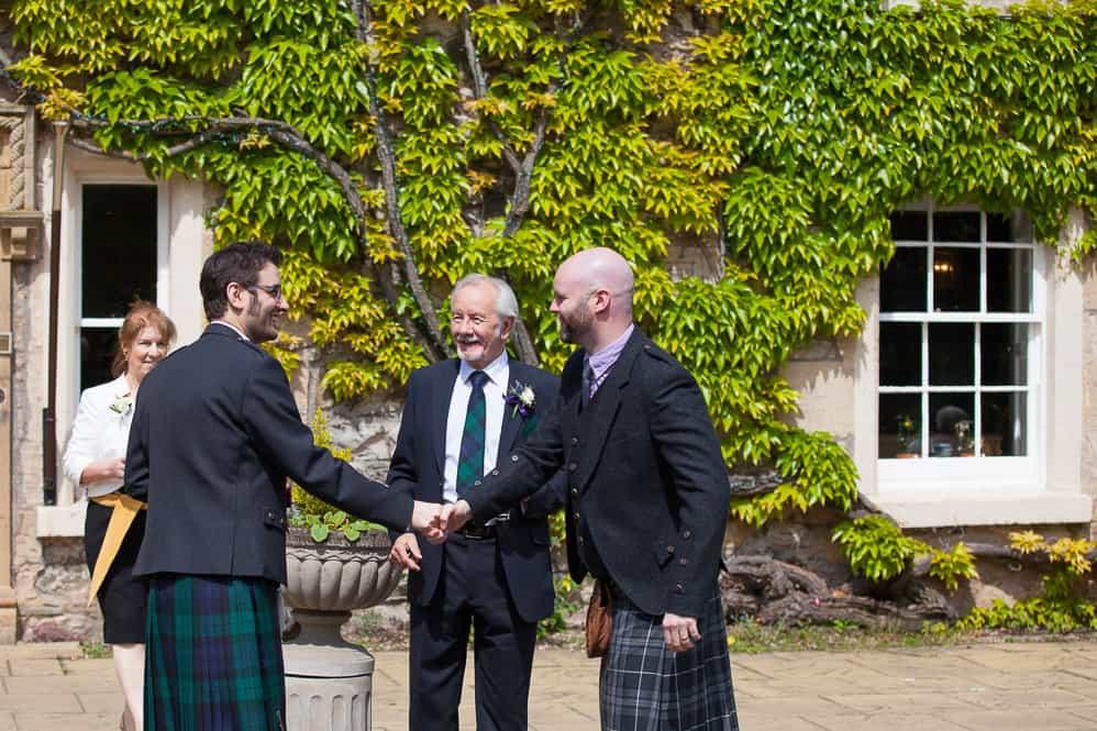 8 groom welcoming guests