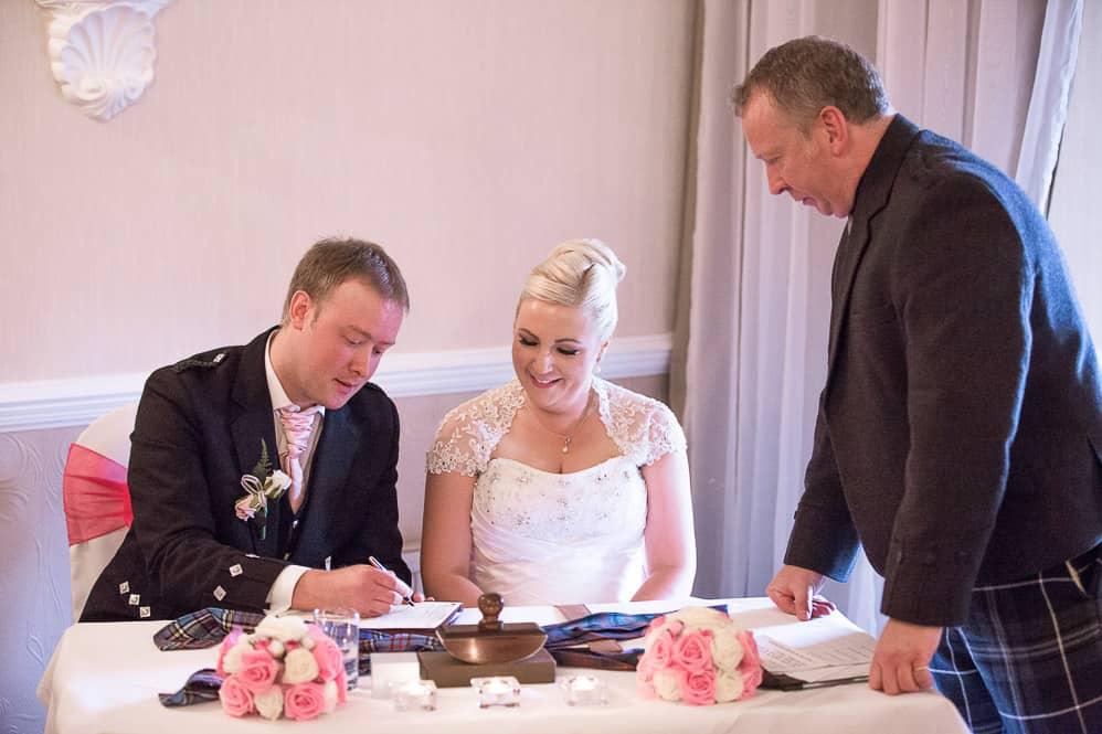 11 groom signing register