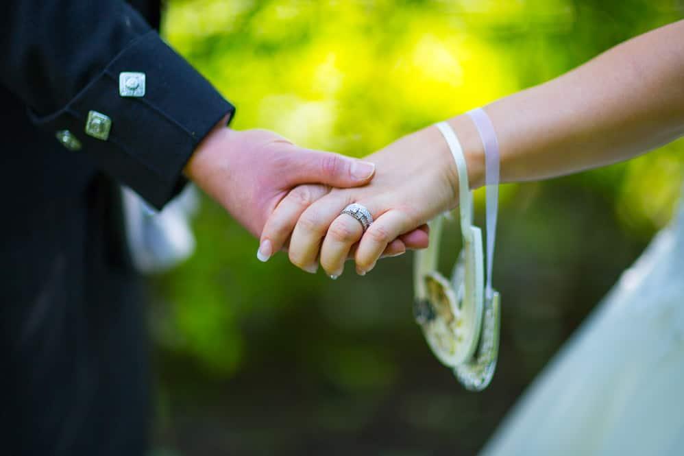 14 newlywed hands closeup