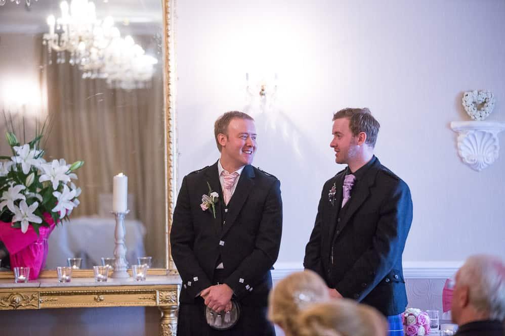 5 groom with bestman awaiting bride