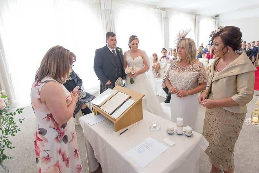 16 lighting candles on wedding