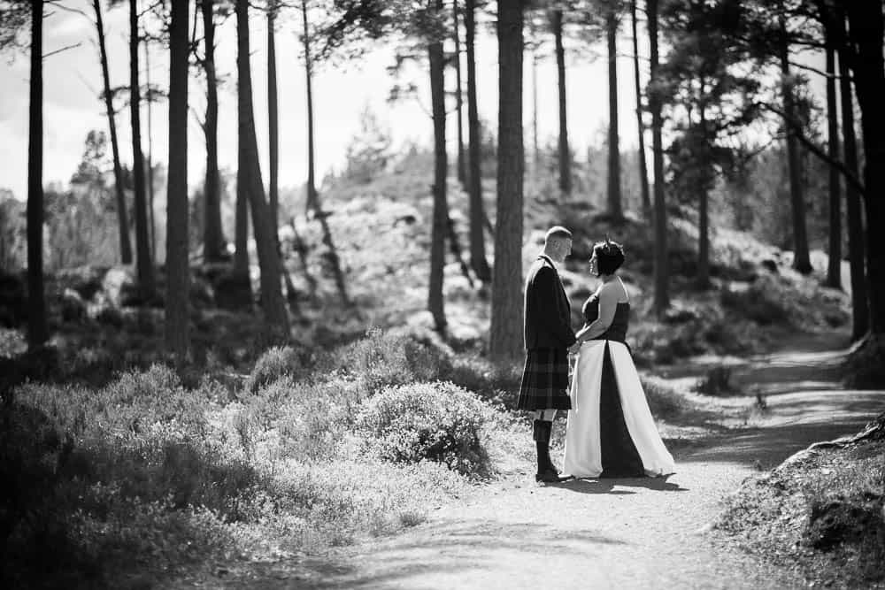 25 bride and groom in woods b&w