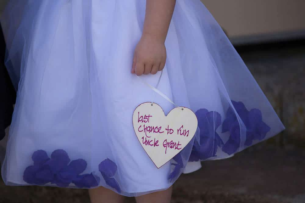 6 flowergirl with heart shape sign