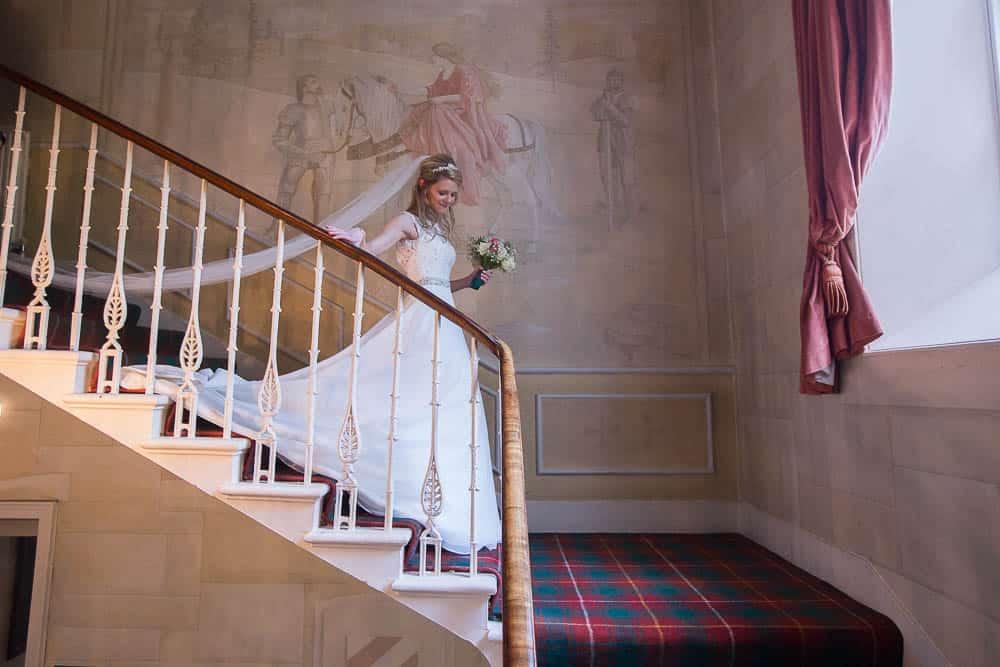 Fernie Castle wedding elegant bride on stairs long veil