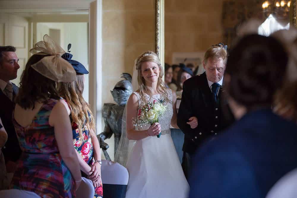 Fernie Castle wedding bride with father walking dawn the aisle