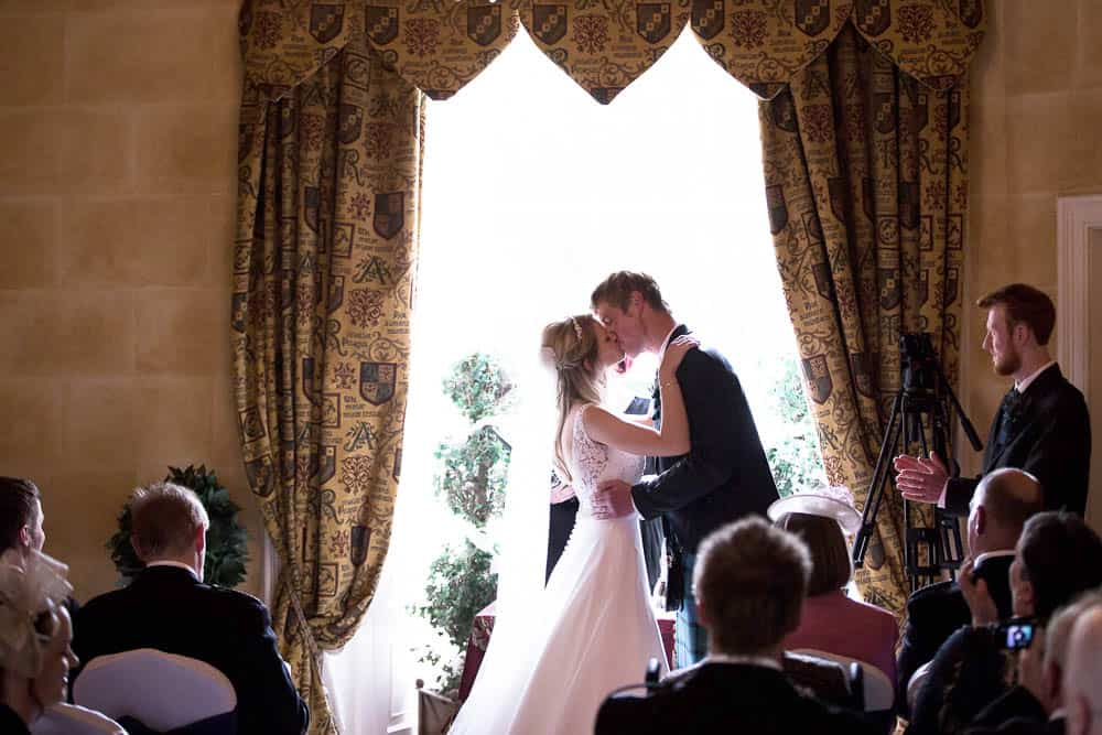 Fernie Castle wedding first kiss of bride and groom ceremony