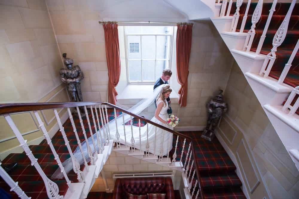 Fernie Castle wedding newlywed couple walking dawn the stairs