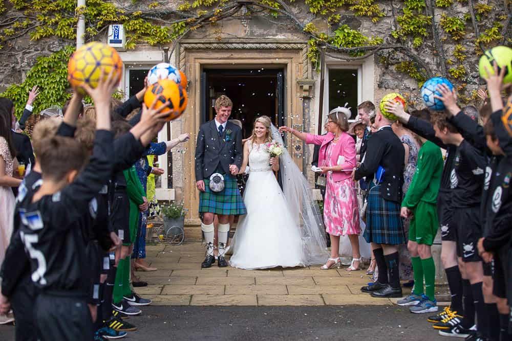 Fernie Castle wedding happy newlywed confetti and balls