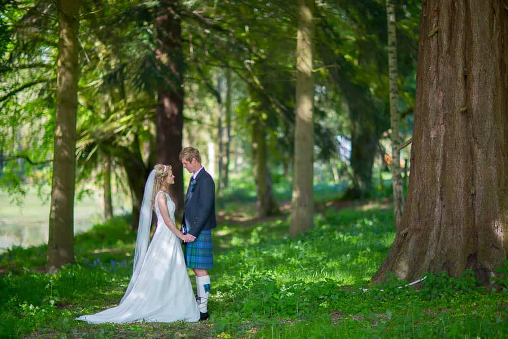Fernie Castle wedding photography woods with bride and groom