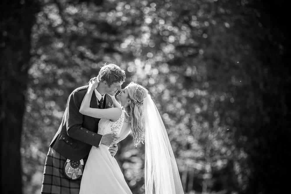 Fernie Castle wedding photography black and white couple kissing