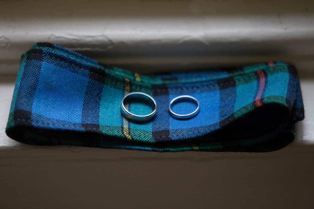 Fernie Castle wedding rings on tartan