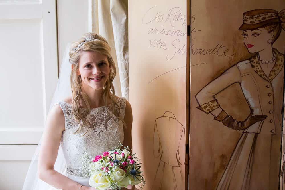 Fernie Castle wedding happy bride with flowers