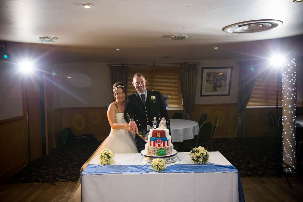 34 bride and groom cutting wedding cake