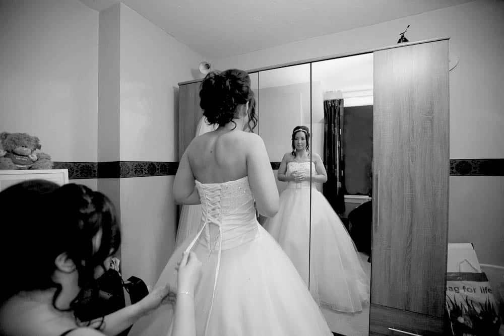 6 bride putting on dress
