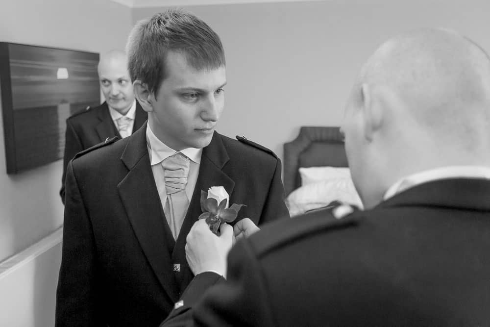 keavil house hotel wedding bestman is getting ready black and white