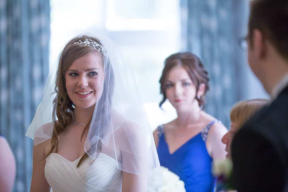 keavil house hotel wedding bride looking at the groom and smiling at wedding ceremony