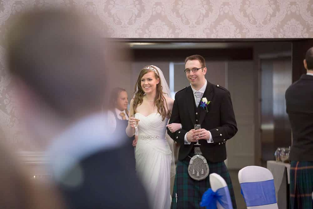 keavil house hotel wedding mr & mrs holding champagne glasses