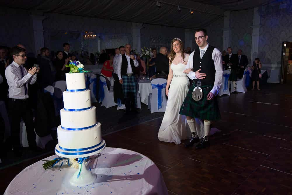 keavil house hotel wedding evening reception bride and groom are walking to cut a cake