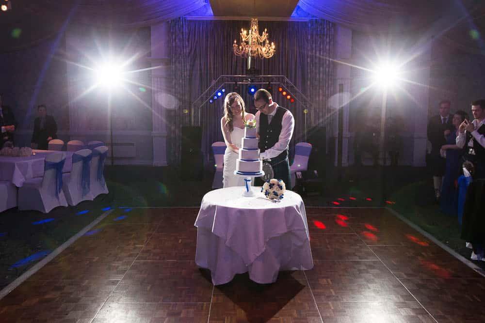 keavil house hotel wedding bride and groom cutting wedding cake