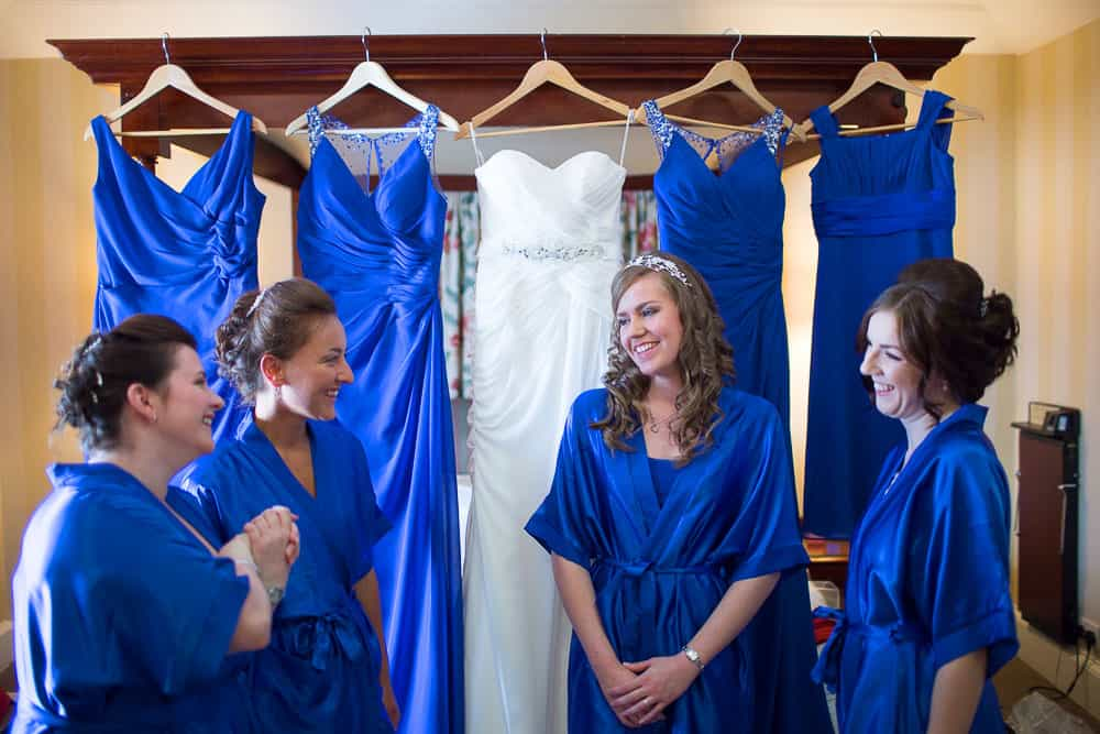 keavil house hotel wedding bride and bridesmaids wearing blue gowns and having informal chat