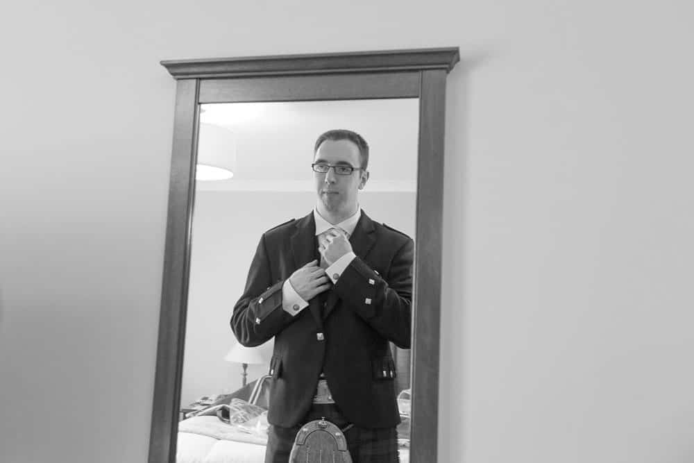 keavil house hotel wedding groom is getting ready in mirror black and white