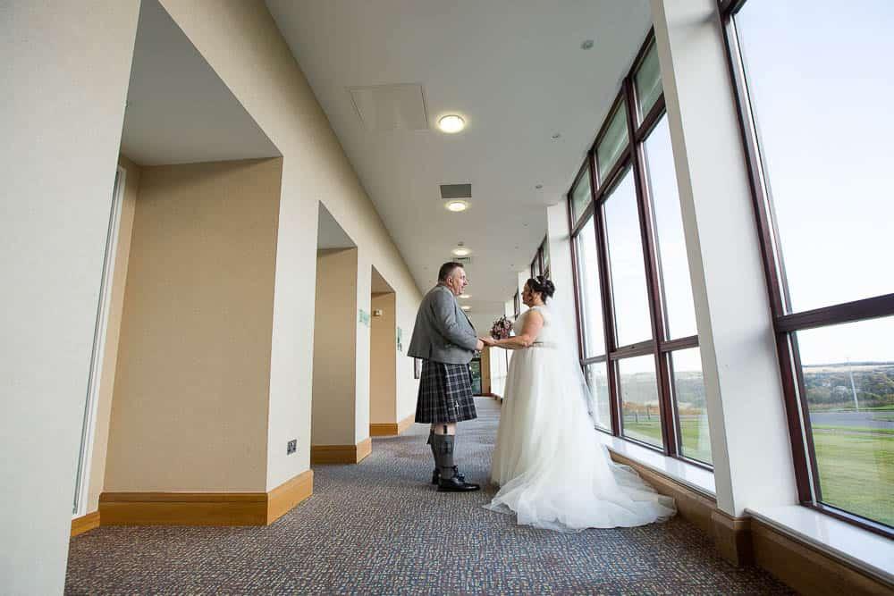 wedding photographer westerwood hotel - bride and groom at hall