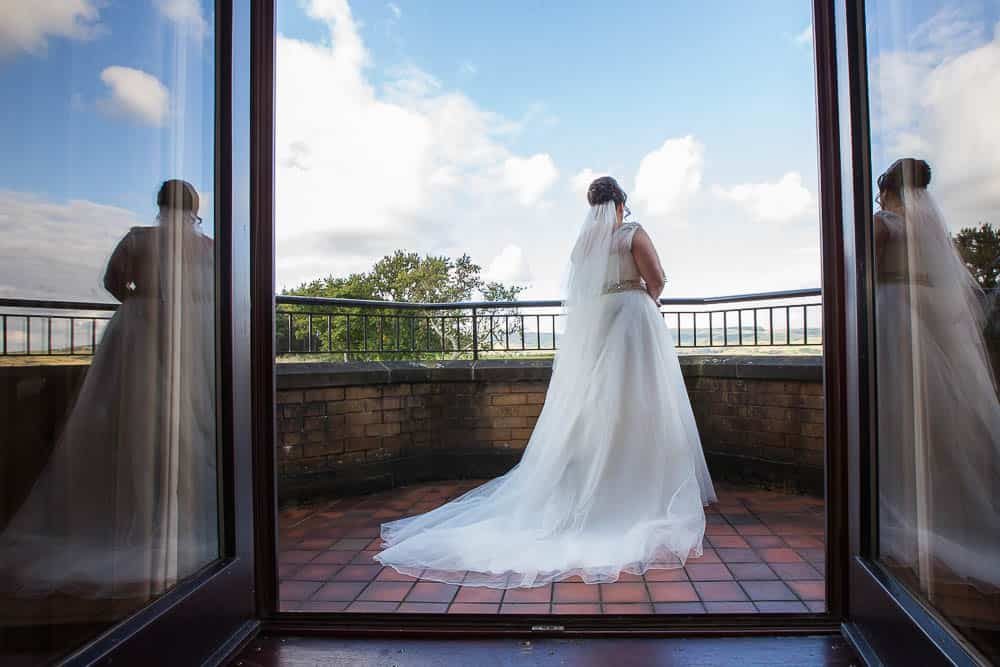 wedding photographer westerwood hotel - bride on balcony