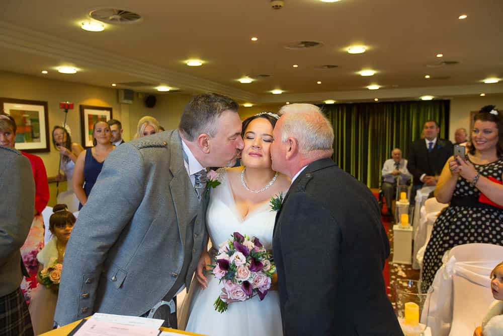wedding photography glasgow - groom and father kissing bride