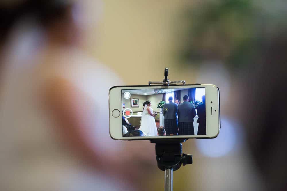 wedding photography westerwood hotel - wedding seen in smartphone